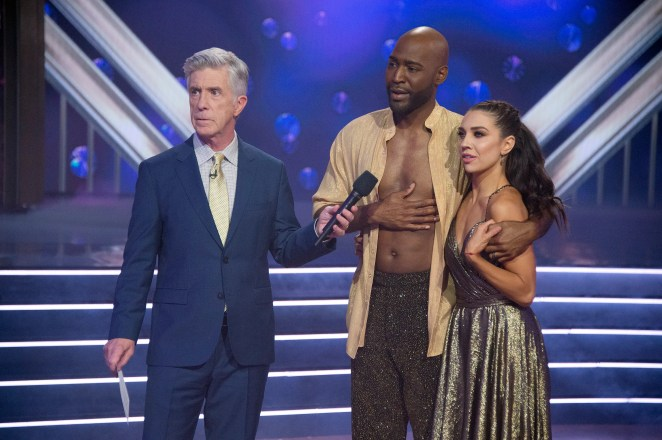 """Host Tom Bergeron stands with Karamo and Jenna Johnson as they learn their fate on Season 28 of """"DWTS."""""""