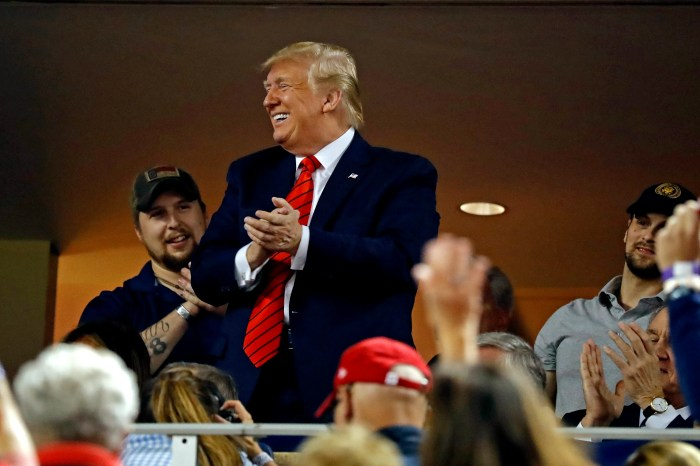 President Donald Trump acknowledges the crowd at Game 5 of the World Series.