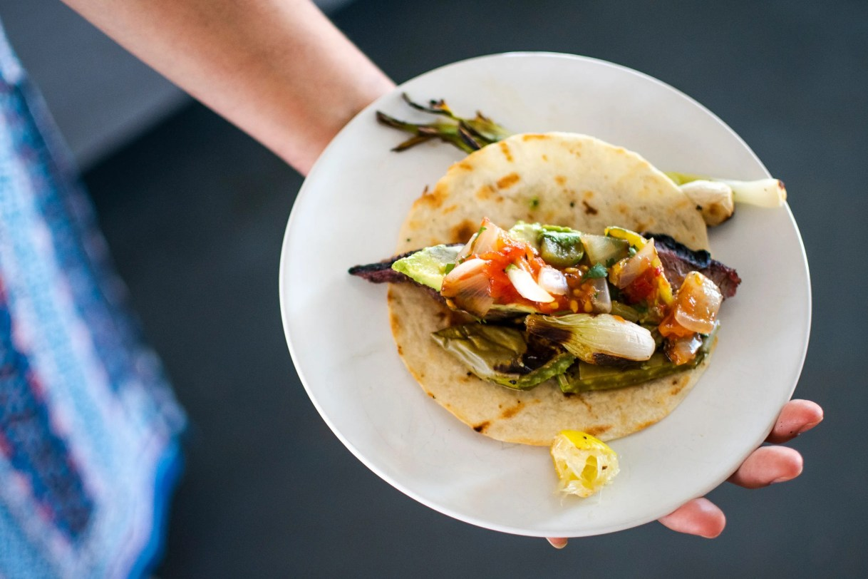 Minerva Orduno Rincon, a chef and culinary instructor, shares her recipe for beer-marinated carne asada, which she served atop a tortilla with salsa, nopales and avocado.