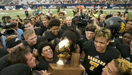 Scottsdale Saguaro High has won a lot of state championships in football, but the team's dynasty is about much more than winning.
