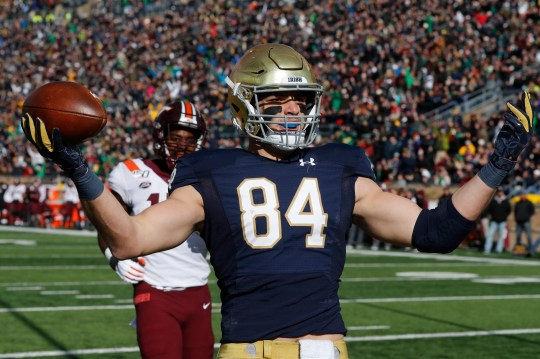 Notre Dame's tight end Cole Kmet (84) celebrates an 8-yard touchdown reception during the first half of an NCAA college football game against Virginia Tech, Saturday November 2, 2019, in South Bend, Ind.