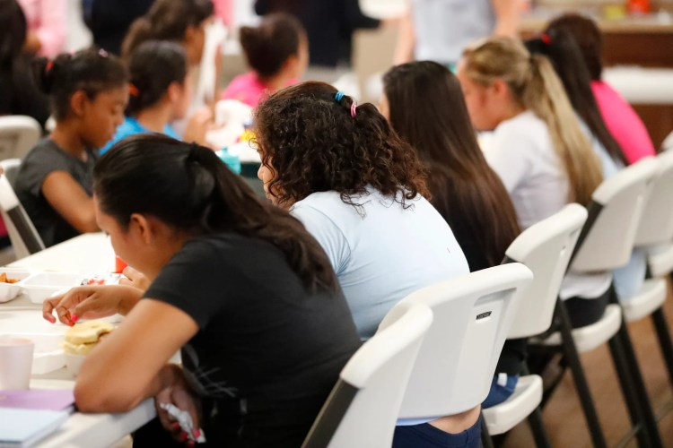 Girls eat lunch at a shelter for migrant teenage girls, in Lake Worth, Florida, on Sept. 24, 2019.