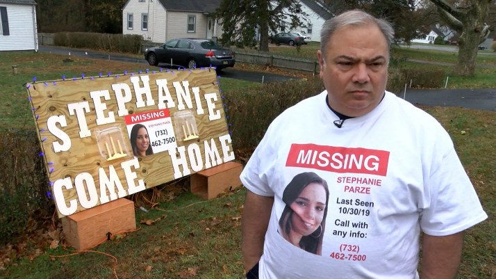 Edward Parze stands next to a large sign Monday, November 18, 2019, outside his Freehold home that asks his missing daughter Stephanie to come home.  The woman has been missing since the night before Halloween.