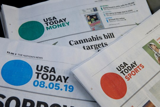 FILE - In this Aug. 5, 2019, file photo, sections of a USA Today newspaper rest together in Norwood, Mass. GateHouse Media has closed on its takeover of Gannett, bringing about 260 daily papers together to become the country's largest newspaper company by far.