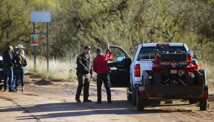 Sheriff's deputies and volunteers organize near Bar X road and Tonto Creek where a truck was swept away in rushing water the day before in Tonto Basin, Ariz. on Nov. 30, 2019.