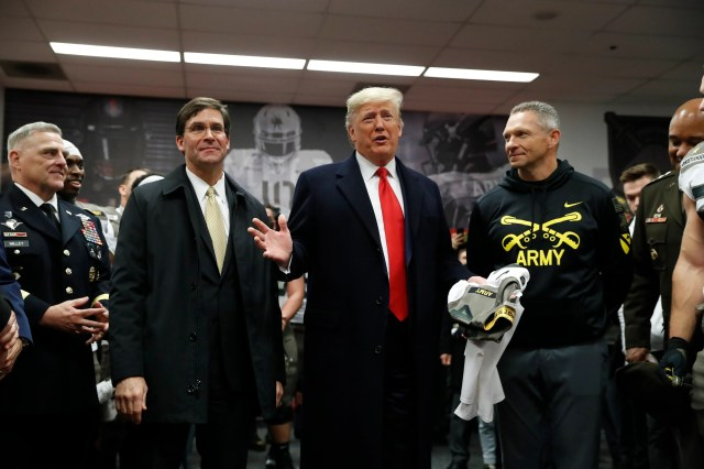 e0a41055-a920-4dd9-bc90-20fd8145a421-army_AP_Trump_2 President Donald Trump receives rousing welcome from crowd at 120th Army-Navy game