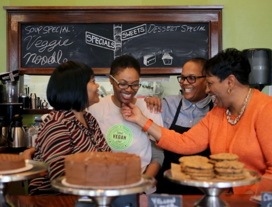 Pastry Chef Irene Pegram, left, with her daughter Kirsten Ussery-Boyd, co-owner of Detroit Vegan Soul with her partner Erika Boyd, and Erika's mother Jeanette Girty, at their restaurant on Tuesday, May 3, 2016.