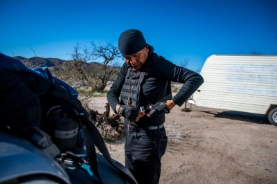 Wendsler Nosie puts on his bulletproof vest before driving through the Oak Flat area on Friday, December 20, 2019.
