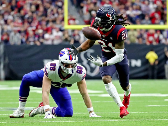 Houston Texans cornerback Bradley Roby (21) misses a catch against Buffalo Bills tight end Dawson Knox (88) during the first quarter in the AFC wild-card playoff game at NRG Stadium.