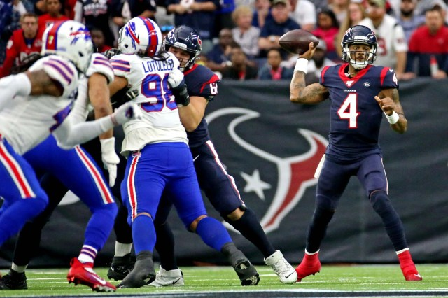 Houston Texans quarterback Deshaun Watson (4) throws a pass during the first quarter against the Buffalo Bills in the AFC wild-card playoff game at NRG Stadium.