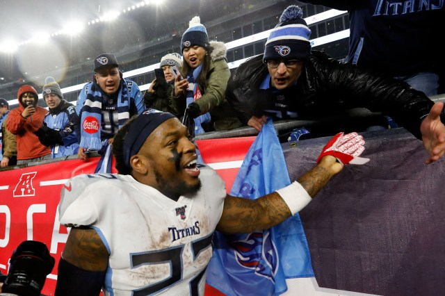 Tennessee Titans running back Derrick Henry (22) celebrates with fans after defeating the New England Patriots at Gillette Stadium.