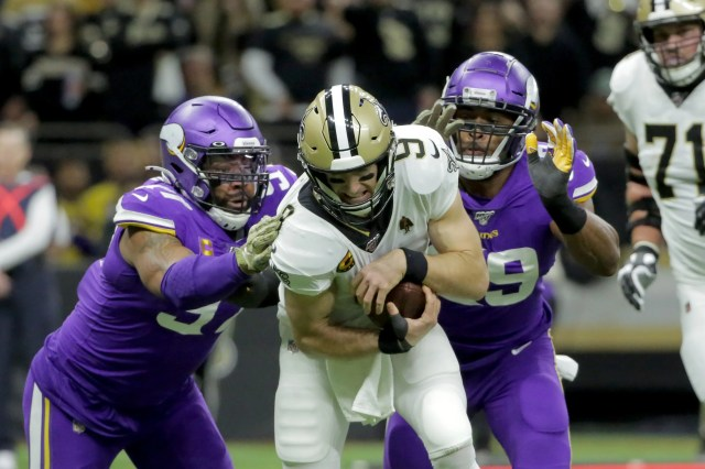 Minnesota Vikings defensive end Everson Griffen (97) and defensive end Danielle Hunter (99) sack New Orleans Saints quarterback Drew Brees (9) during the first quarter of a NFC wild-card playoff football game at the Mercedes-Benz Superdome.
