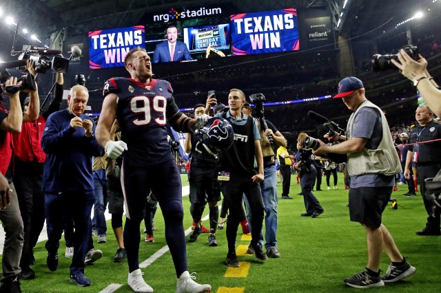 Houston Texans defensive end J.J. Watt (99) walks off the field after beating the Buffalo Bills in the AFC wild-card playoff game at NRG Stadium.