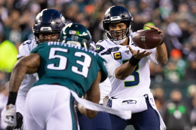 Seahawks quarterback Russell Wilson takes a snap.