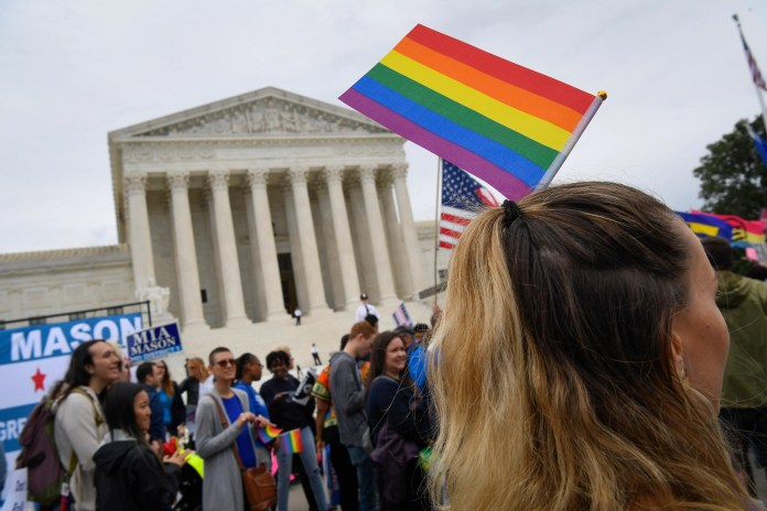 The protesters met in front of the Supreme Court in October when the judges heard challenges involving workers who claimed they were fired for being gay or transgender.