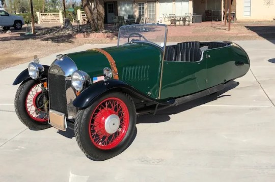This Morgan F4 green roadster was built in 1937 and features a right-hand drive and three wheels.