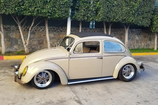 This custom 1958 Volkswagen Beetle has been restored and features new custom Klassik Rader wheels and a tweed interior unites everything.