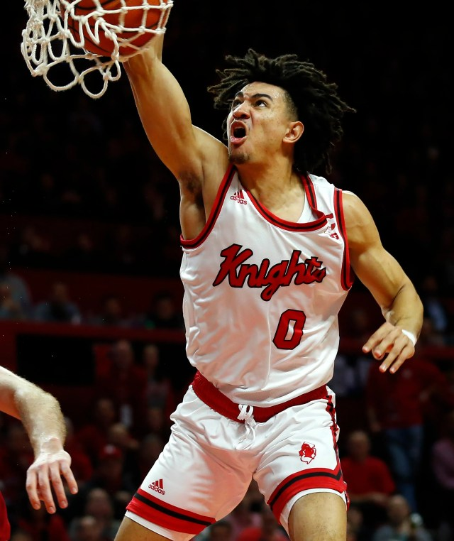 Rutgers Scarlet Knights guard Geo Baker (0) dunks against the Indiana Hoosiers during the second half at Rutgers Athletic Center (RAC).