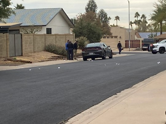 Phoenix police investigate the fatal shooting of a man inside a car near 26th Street and Shea Boulevard on Jan. 16, 2020.
