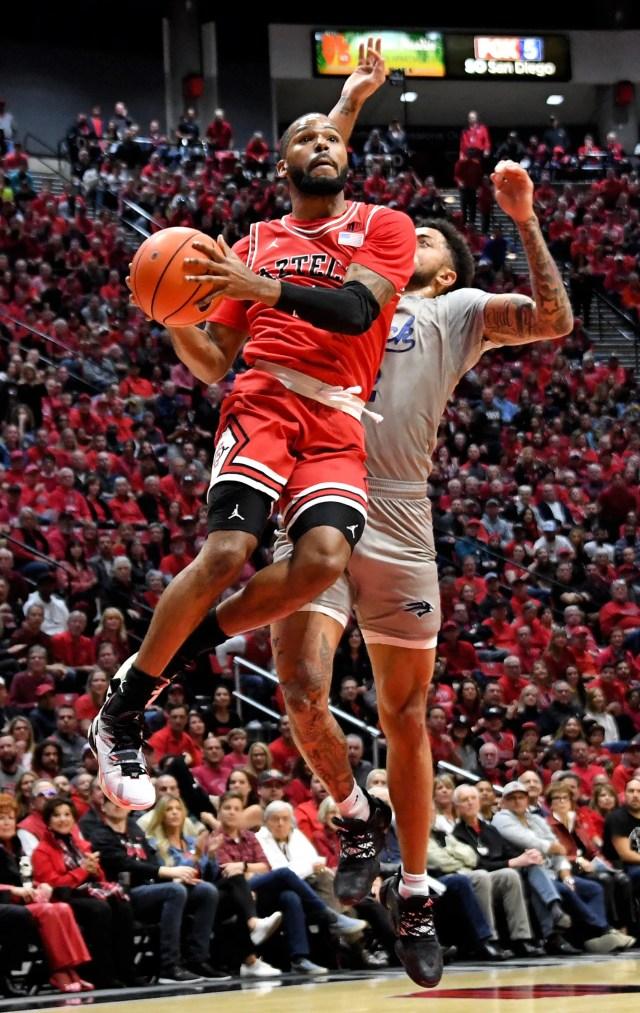 Jan 18, 2020; San Diego, California, USA; San Diego State Aztecs forward Matt Mitchell (11) drives to the basket against Nevada Wolf Pack guard Jalen Harris (2) during the first half at Viejas Arena. Mandatory Credit: Kirby Lee-USA TODAY Sports