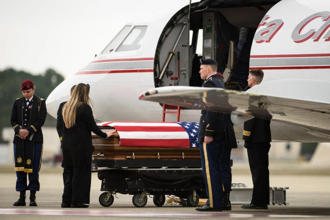 Tarah McLaughlin, the widow of Staff Sgt. Ian Paul McLaughlin, touches her husband's coffin on Saturday, Jan. 18, 2020, on Fort Bragg, N.C. McLaughlin was killed Jan. 11 in Afghanistan.