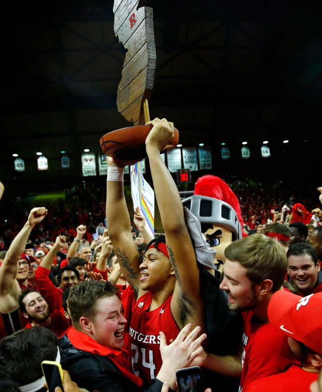 Rutgers Scarlet Knights guard Ron Harper Jr. (24) raises the Garden State Hardwood Classic trophy after defeating the Seton Hall Pirates at Rutgers Athletic Center.