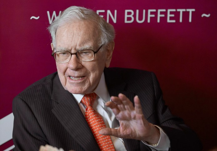 Warren Buffett, chairman and CEO of Berkshire Hathaway, speaks during a game of bridge following the annual Berkshire Hathaway shareholders meeting in Omaha in this 2019 photo.