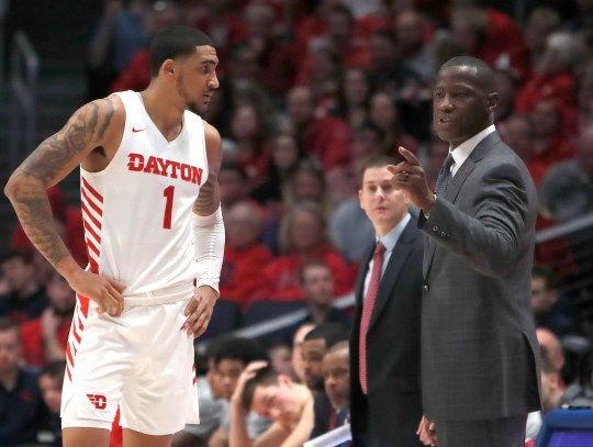 Dayton Flyers forward Obi Toppin (1) talks with head coach Anthony Grant during the first half against the Duquesne Dukes at University of Dayton Arena.