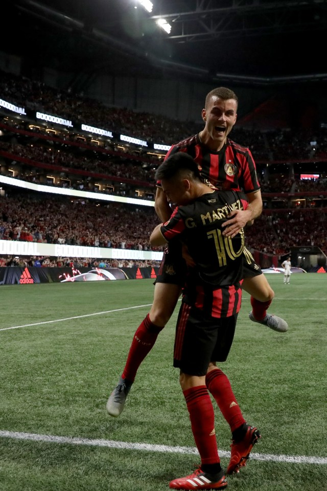 Mar 7, 2020; Atlanta, Georgia, USA; Atlanta United defender Brooks Lennon (11) celebrates with midfielder Pity Martinez (10) after a goal by midfielder Ezequiel Barco (not pictured) against FC Cincinnati in the first half at Mercedes-Benz Stadium. Martinez had an assist on the play. Mandatory Credit: Jason Getz-USA TODAY Sports