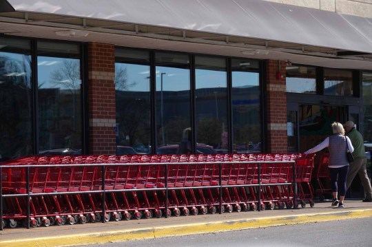 Buyers grab grocery carts from Trader Joe's on Rt. 202 Monday morning. The shelves were filled with food. Toilet paper was available but limited to one package per customer.