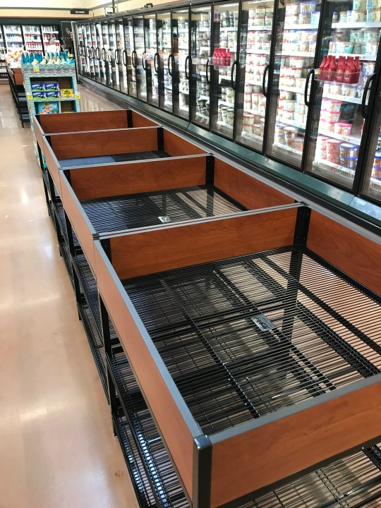 Empty shelves and aisles have become the norm in grocery stores in Greater Cincinnati. This photo was taken at the Blue Ash Kroger on Tuesday March 17, 2020.