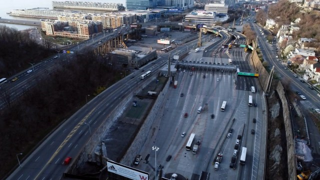 An aerial view of the Lincoln Tunnel entrance during the morning rush hour commute on March 18, 2020, where few cars are seen on the road during the coronavirus outbreak.