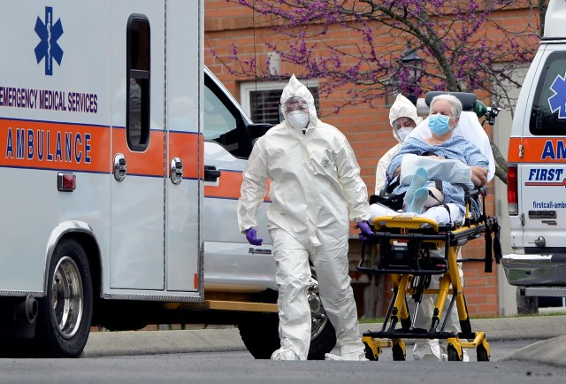 Medical personnel take people out of the Gallatin Center for Rehabilitation and Healing on Monday, March 30, 2020, in Gallatin Tenn. As of Sunday, 74 residents and 33 staff members at the facility has tested positive for COVID-19, according to a spokesperson for Gov. Bill Lee.