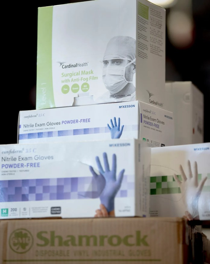 Boxes of donated medical gloves and masks are seen before a press conference held by Texas Governor Greg Abbott discussing the coronavirus on Tuesday March 24, 2020 in Austin, Texas.