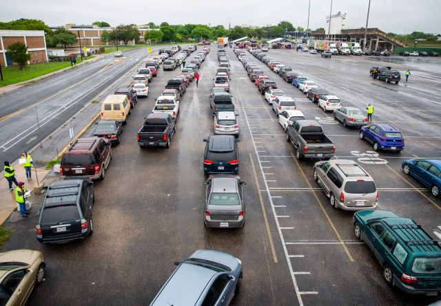 Over 3,000 vehicles made their way to the parking lot of Nelson Field at Reagan Early College High School in northeast Austin to pick up to a 30-pound box of food April 4, 2020. President and CEO of Central Texas Food Bank in Austin, Texas.