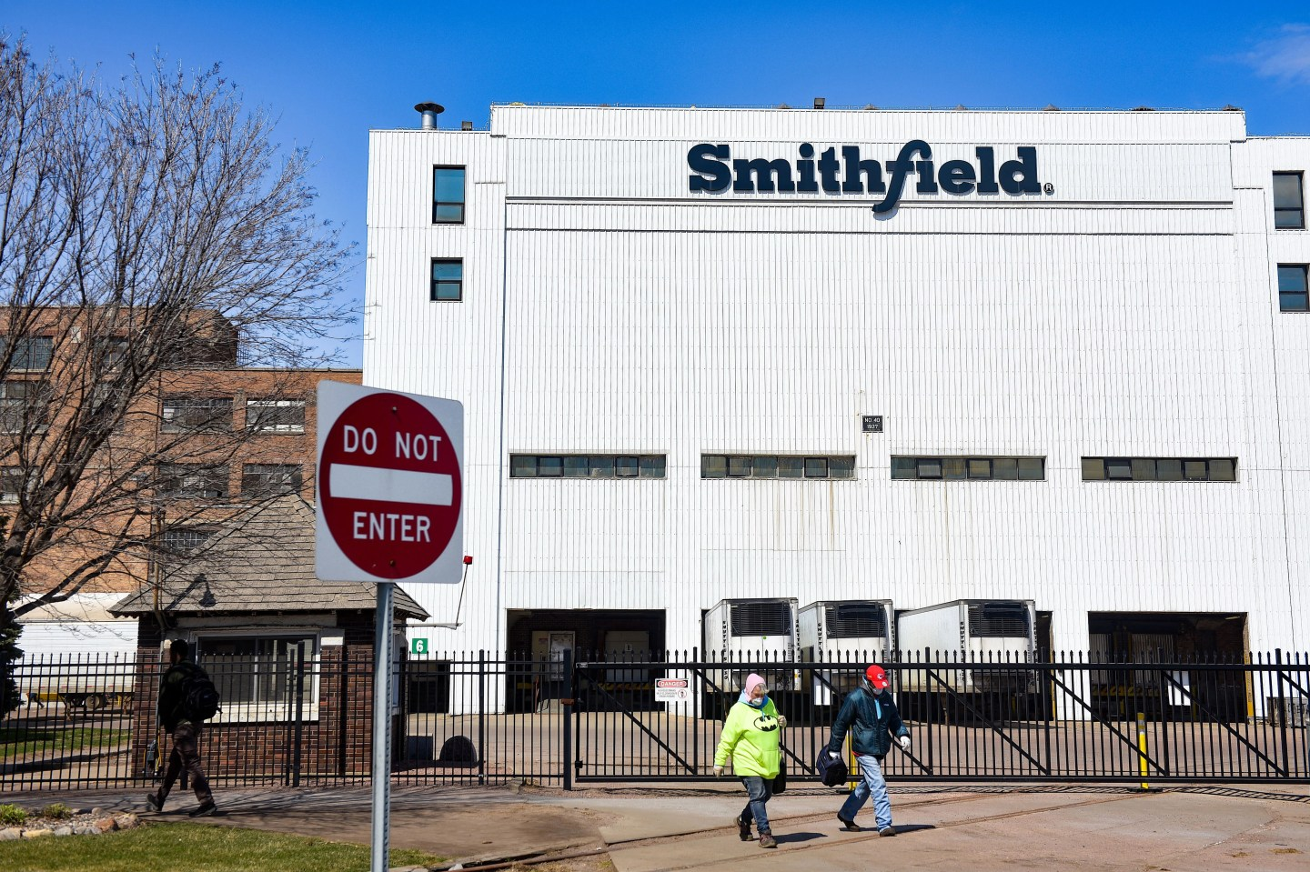 Smithfield Foods employees wear masks at shift change on April 8 in Sioux Falls, South Dakota.