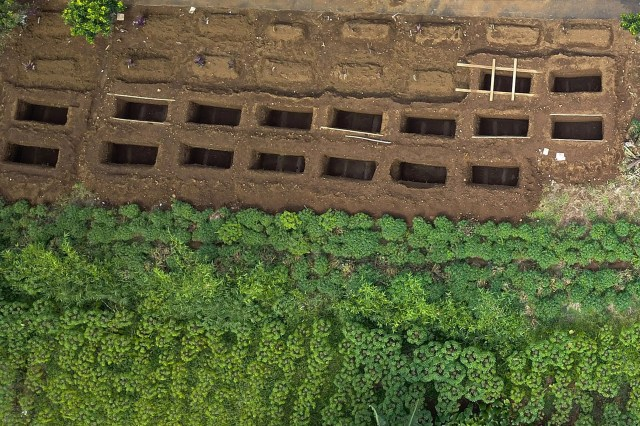 This aerial photo taken on April 17, 2020 shows graves for victims of the COVID-19 coronavirus in Bogor, West Java.