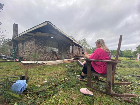 Penny Temples, a teacher at Lumberton High School, assessed the damage on April 20, the morning after a tornado hit Baxterville, Miss.