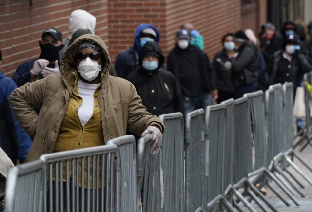 People wait in line for a coronavirus test at one of the new walk-in COVID-19 testing sites that opened at the located in the parking lot of NYC Health + Hospitals/Gotham Health Morrisania in the Bronx Section of New York on April 20, 2020.