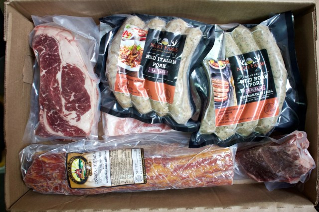 """A direct to consumer """"grill box"""" is packaged for distribution on April 28. The box includes steaks, sausages, pork chop and pork belly among other items from Nicky USA."""