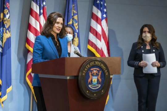 Michigan Gov. Gretchen Whitmer, left, gives an update to the state's response to the coronavirus on Monday, May 11, 2020. Whitmer is joined by Chief Medical Executive Dr. Joneigh Khaldun, center, and Chief Operations Officer Tricia Foster.