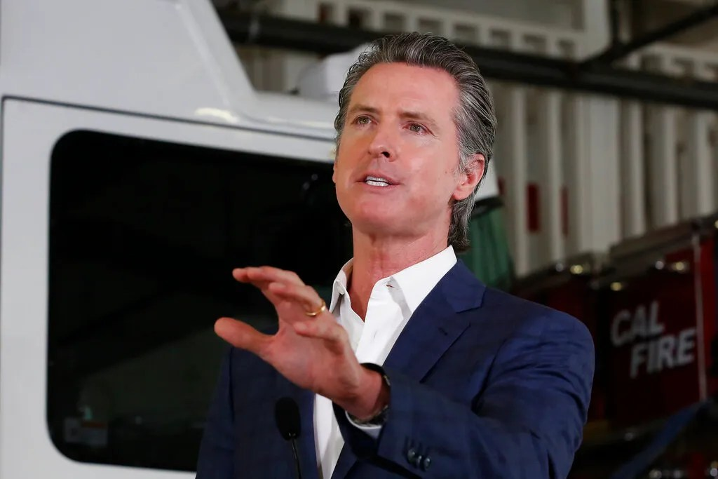 Gov. Gavin Newsom discusses his revised state budget proposal during a news conference at the CalFire/Cameron Park Fire Station in Cameron Park, Calif., Wednesday, May 13, 2020. Los Angeles County reopened its beaches Wednesday in the latest cautious easing of coronavirus restrictions that have closed most California public spaces and businesses for nearly two months. (AP Photo/Rich Pedroncelli, Pool)