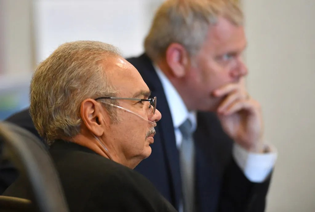 Gilberto Rios, left, and his attorney Jeff Young listen to testimony in court.