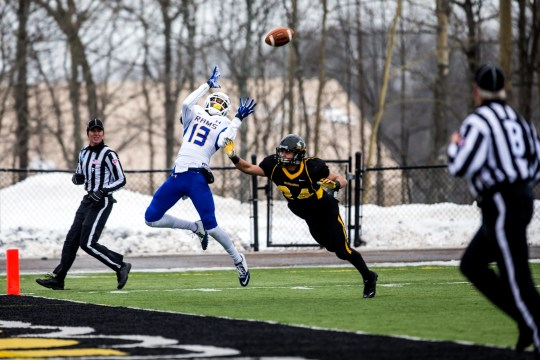 Anthony Yancy, Angelo State, jumped into the cold to catch the final zone for a touchdown during the first round playoffs of the NCAA Division II Rams against Michigan Tech in Houghton, Michigan, on November 22, 2014.