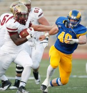 Rush Seaver from Angelo State University pursues Keidrick Jackson in the Midwestern State on October 27, 2013.