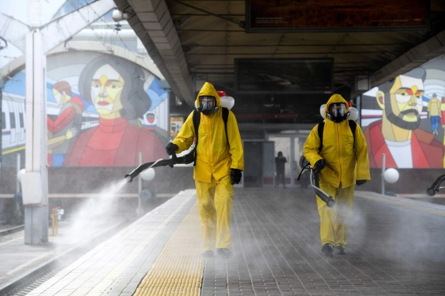 Servicemen of Russia's Emergencies Ministry wearing protective gear disinfect Moscow's Leningradsky railway station on May 19, 2020, amid the COVID-19 coronavirus pandemic.