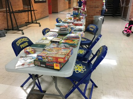 A table of puzzles, books and other donated items was set up in the basement of Midland High School for flood evacuees.