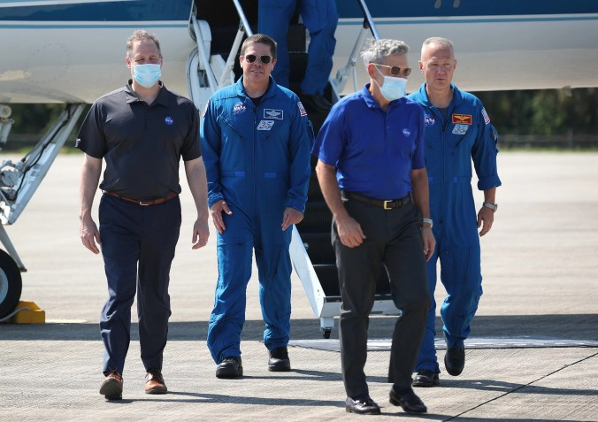 From left, NASA Administrator Jim Bridenstine, astronaut Bob Behnken, Kennedy Space Center Director Robert Cabana and astronaut Doug Hurley at Cape Canaveral, Florida, on May 20, 2020.