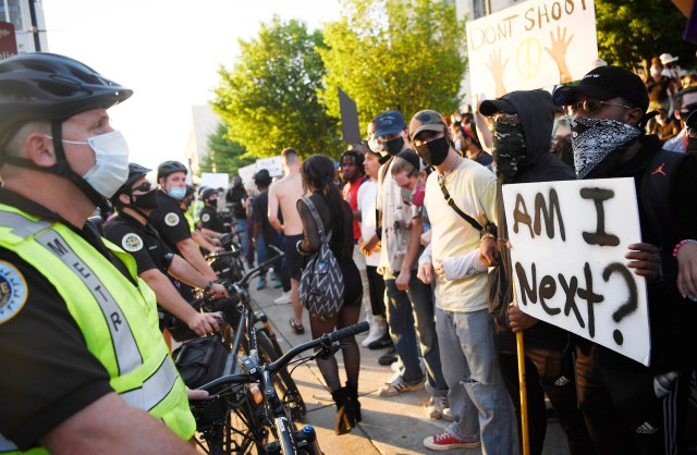 """Metro Nashville Police and protesters face off outside Metro Courthouse in Nashville, Tennessee, on May 30, 2020, after the """"I Will Breathe"""" rally to protest the death of George Floyd, an unarmed black man who died after being pinned down by a white Minneapolis police officer."""
