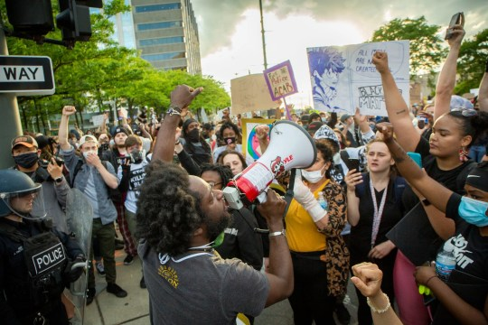 Protesters in downtown Detroit march and stop at the Detroit Police Station for a second night of protests on May 30, 2020.